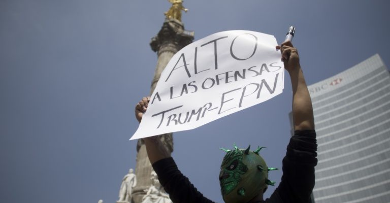 A demonstrator protests against the inminent visit of US presidential candidate Donald Trump to Mexico, in Mexico City on August 31, 2016. Donald Trump was expected in Mexico Wednesday to meet its president, in a move aimed at showing that despite the Republican White House hopeful's hardline opposition to illegal immigration he is no close-minded xenophobe. Trump stunned the political establishment when he announced late Tuesday that he was making the surprise trip south of the border to meet with President Enrique Pena Nieto, a sharp Trump critic. / AFP PHOTO / Alejandro AYALAALEJANDRO AYALA/AFP/Getty Images ** OUTS - ELSENT, FPG, CM - OUTS * NM, PH, VA if sourced by CT, LA or MoD **